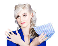 Adorable female pinup cleaner holding dish cloth Stock Photos