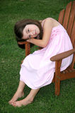 Adorable Five Year Old Girl. Beautiful five year old girl sitting in a chair in the yard Royalty Free Stock Photos
