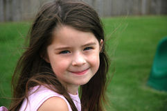 Adorable Five Year Old Girl. Sweet little girl with hair blowing in the wind Stock Image