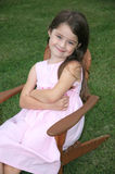 Adorable Five Year Old Girl. Little girl sitting in a lawn chair Stock Photos