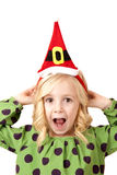 Adorable fun blond girl wearing a santa hat Royalty Free Stock Photo