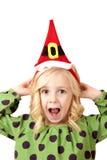 Adorable fun blond girl wearing a santa hat Royalty Free Stock Photo