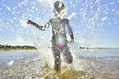 Adorable funny baby girl splashing in the water Royalty Free Stock Image