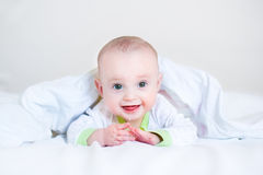 Adorable funny laughing baby playing peek-a-boo Stock Photo