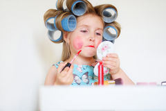 Adorable funny little girl making makeup with mother cosmetics Stock Images