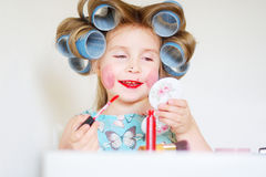 Adorable funny little girl making makeup with mother cosmetics Royalty Free Stock Photography