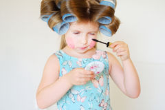 Adorable funny little girl making makeup with mother cosmetics Royalty Free Stock Photo