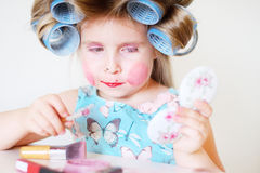 Adorable funny little girl making makeup with mother cosmetics Stock Photography