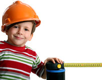 Adorable future architect in helmet with rule Royalty Free Stock Photo