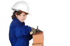 Adorable future builder constructing a brick wall Stock Photography