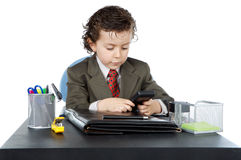 Adorable future businessman in your office Royalty Free Stock Photos