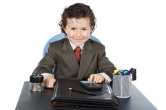 Adorable future businessman in your office Stock Images
