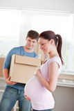 Adorable future mother with husband in their house Royalty Free Stock Image