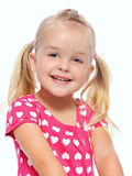Adorable girl. Adorable blonde girl with pigtails smiles in studio, isolated on white royalty free stock image