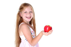 Adorable girl with apple Royalty Free Stock Photos