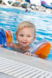 Adorable girl in armbands in swimming pool Stock Photography