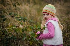 Adorable girl in autumn forest royalty free stock photos