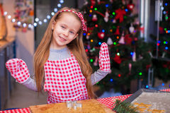 Adorable girl baking gingerbread cookies for Stock Image