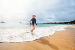 Adorable girl at beach. During summer vacation stock image