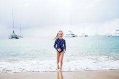 Adorable girl at beach. During summer vacation stock photo