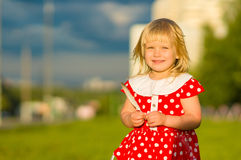 Adorable girl in beautiful dress hold feather Stock Images