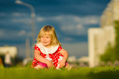 Adorable girl in beautiful dress sit on grass Royalty Free Stock Images