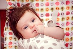 Adorable girl on the bed royalty free stock image