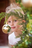 Adorable girl behind the tree Royalty Free Stock Photos