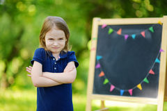 Adorable girl being unhappy about going to school Stock Photography
