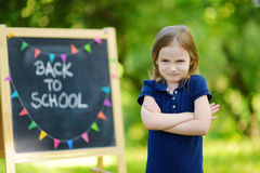 Adorable girl being unhappy about going to school Royalty Free Stock Photography