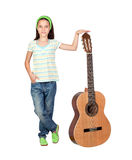 Adorable girl with a big guitar Stock Photos