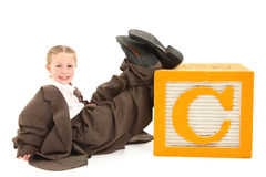 Adorable Girl in Big Suit Stock Photos