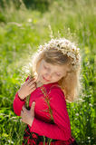 Adorable girl with blond hair and closed eyes Stock Image