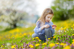 Adorable girl in blooming dandelion flowers Royalty Free Stock Photography