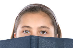 Adorable girl with a book Royalty Free Stock Photo