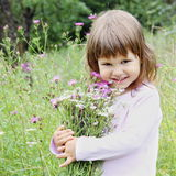 Adorable Girl with Bunch of Flowers Stock Photos