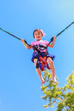 Adorable girl bungee jumping Royalty Free Stock Photos