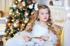Adorable girl by the Christmas tree Stock Image
