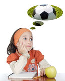 Adorable girl in class thinking about the ball Stock Photos