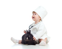 Adorable girl with clothes of doctor and rabbit Royalty Free Stock Images