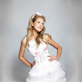 Adorable girl in a costume of Cinderella. Beautiful girl in a costume of Cinderella is looking up Stock Photography