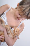 Adorable girl cradles sleeping kitten Royalty Free Stock Image