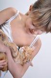 Adorable girl cradles sleeping kitten Royalty Free Stock Image