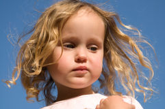 Adorable girl with curly hair Stock Photography