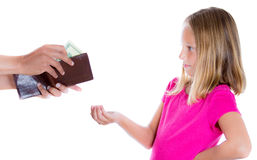 Adorable girl demanding money for allowance, guy pulls out money from wallet to give her. Closeup portrait of adorable girl demanding money for allowance, guy Stock Photos