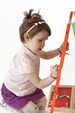 Adorable girl draw on black board with chalk Royalty Free Stock Photography