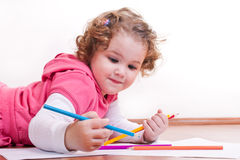 Adorable girl is drawing Royalty Free Stock Photography