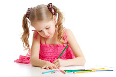 Adorable girl drawing with color pencils Stock Photography