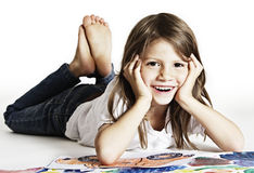 Adorable girl with drawings in studio. Stock Images