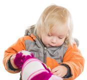 Adorable girl dressing winter jacket and hat Royalty Free Stock Images